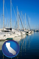 california map icon and sailboats in a marina