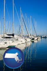 massachusetts map icon and sailboats in a marina