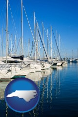 north-carolina map icon and sailboats in a marina