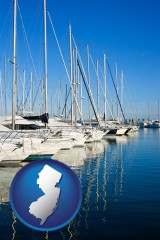 new-jersey map icon and sailboats in a marina
