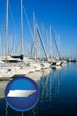 tennessee map icon and sailboats in a marina