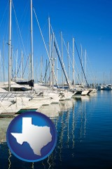 texas map icon and sailboats in a marina
