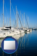 wyoming map icon and sailboats in a marina