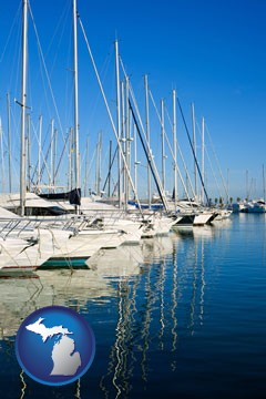 sailboats in a marina - with Michigan icon