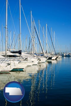 sailboats in a marina - with Nebraska icon