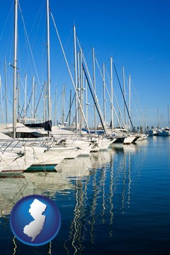 sailboats in a marina - with New Jersey icon
