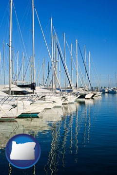 sailboats in a marina - with Oregon icon